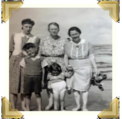 Nellie Heywood (centre) her daughter Doreen (left) and next door neighbour and her children, who Sandie grew up with.
