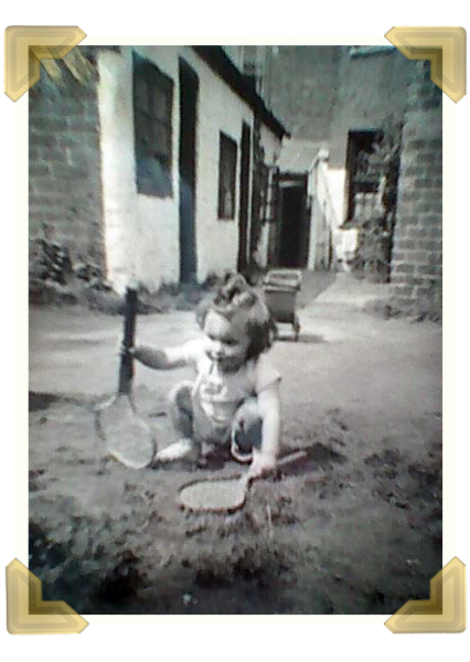 Pat Hunt playing in the yard, the buildings on the right are the washhouses of No 8 and 9 Russell St