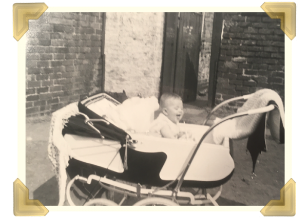 Elaine in her Silver Cross pram in the party-yard at the back of Russell Street