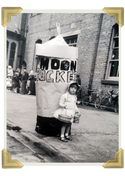 Elaine in fancy dress with cousin Dennis Willetts, inside the space Rocket. He made the space rocket indoors and could hardly get it through the door once he had finished it
