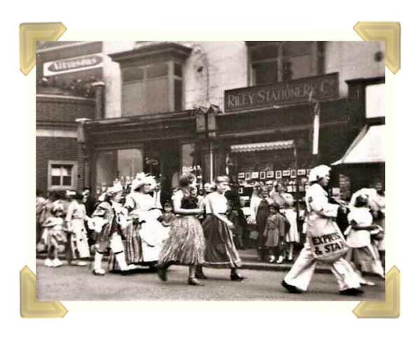 The Robert's family were given Riley's Stationers to take over. This photo is from the 1950s, during the Market Place Parade (Courtesy of Teresa Davies)