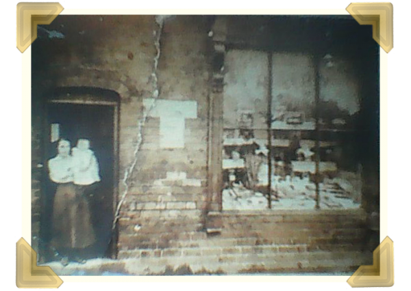 The Russell Street Dairy owned by the Robert's sisters' grandparents. Nan Roberts holding her daughter Constance