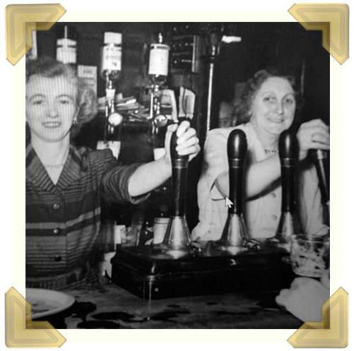 Elaine Costigan's grandmother, Maggie Archer (right) pulling her pint. When she worked there it was called The George Hotel