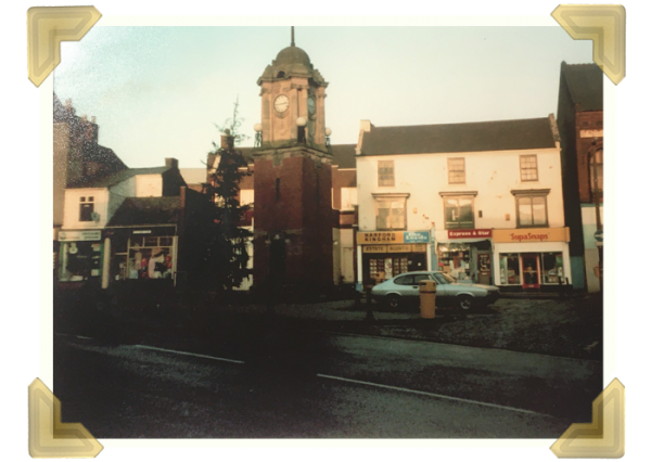 26a Market Place - the middle shop in the row, behind and to the right of the clock tower