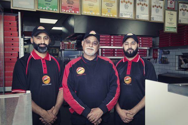 Mr Ali with sons inside Amigos Pizza © Marta Kochanek, Wednesbury High Street Stories, HSHAZ, 2021