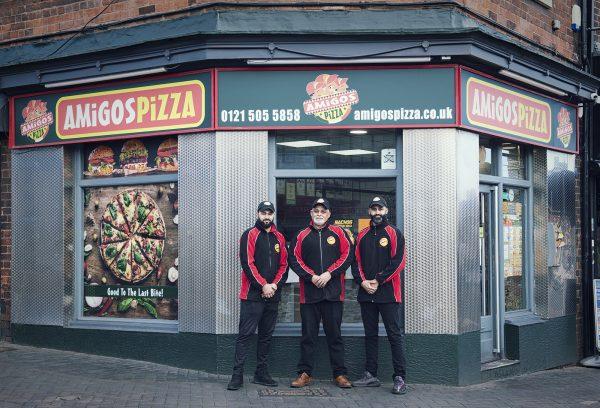 Mr Ali with sons outside Amigos Pizza © Marta Kochanek, Wednesbury High Street Stories, HSHAZ, 2021